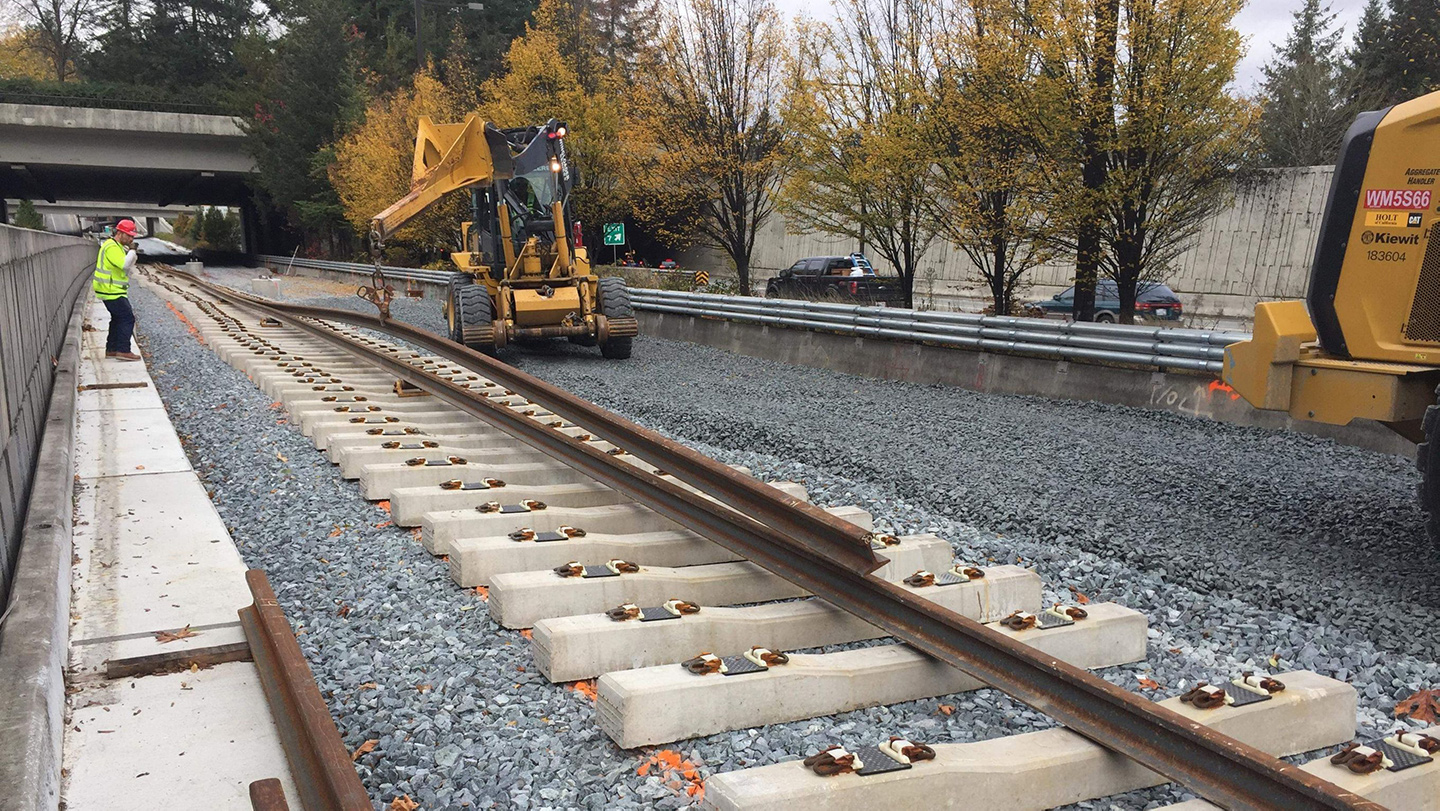 960-foot-long sections of rail are then threaded through clips on either end of the concrete tie.