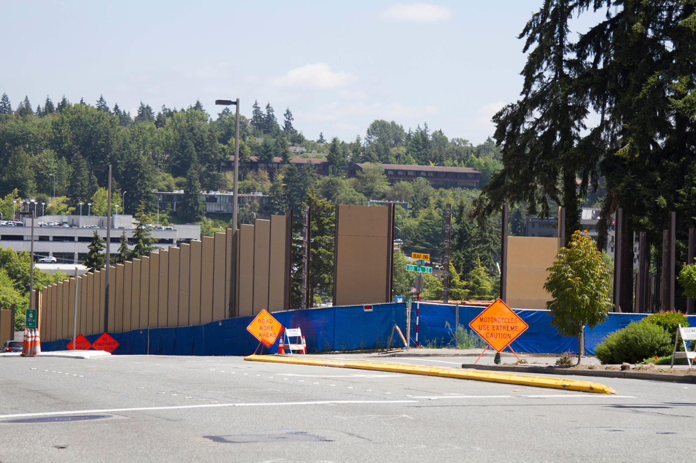 Construction of the temporary sound wall around the south tunnel portal site at Main Street and 112th Avenue NE.