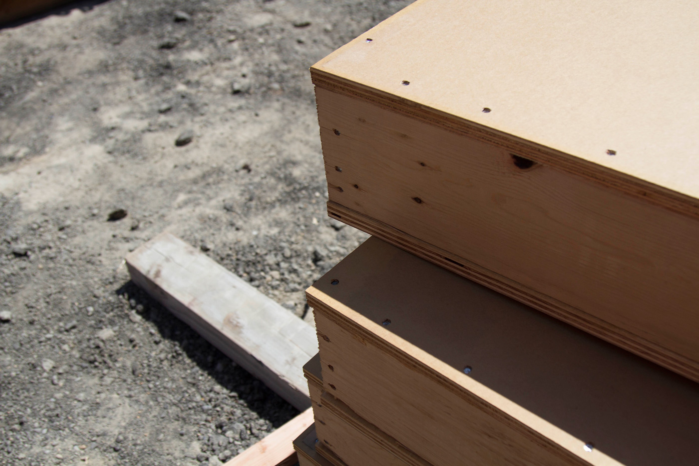 Plywood sheets with a sound-mitigating material for the sound wall.