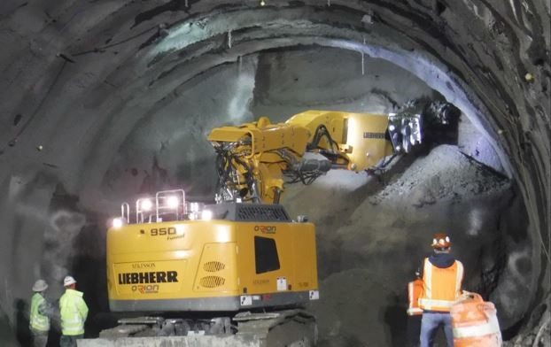 "A giant ""roadheader"" removes soil from the tunnel face."