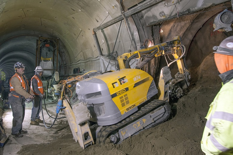 Contractors use remote-controlled excavators to mine each cross passage.