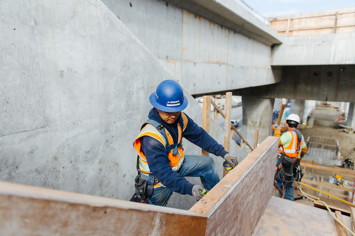 Workers build stairwells at the future Northgate Link light rail station