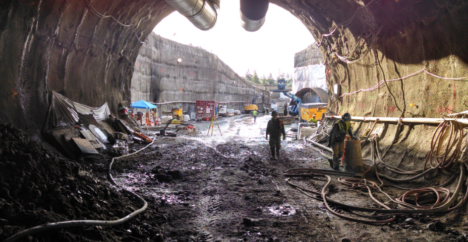 Crew members stand at the south tunnel portal entrance, located at 112th Avenue NE and Main Street.