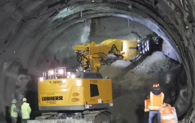 Soil is removed with excavation equipment called a roadheader, which features a rotating cutting head.