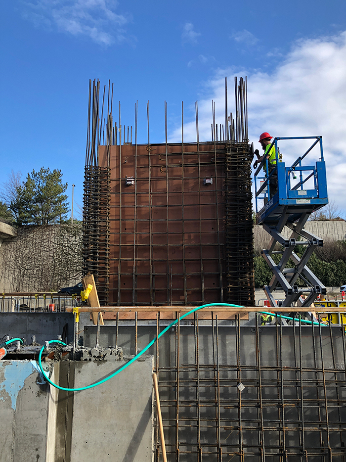 Wood forms and steel rebar are installed to prepare to pour the concrete elevator shaft at the Mercer Island station's west headhouse.