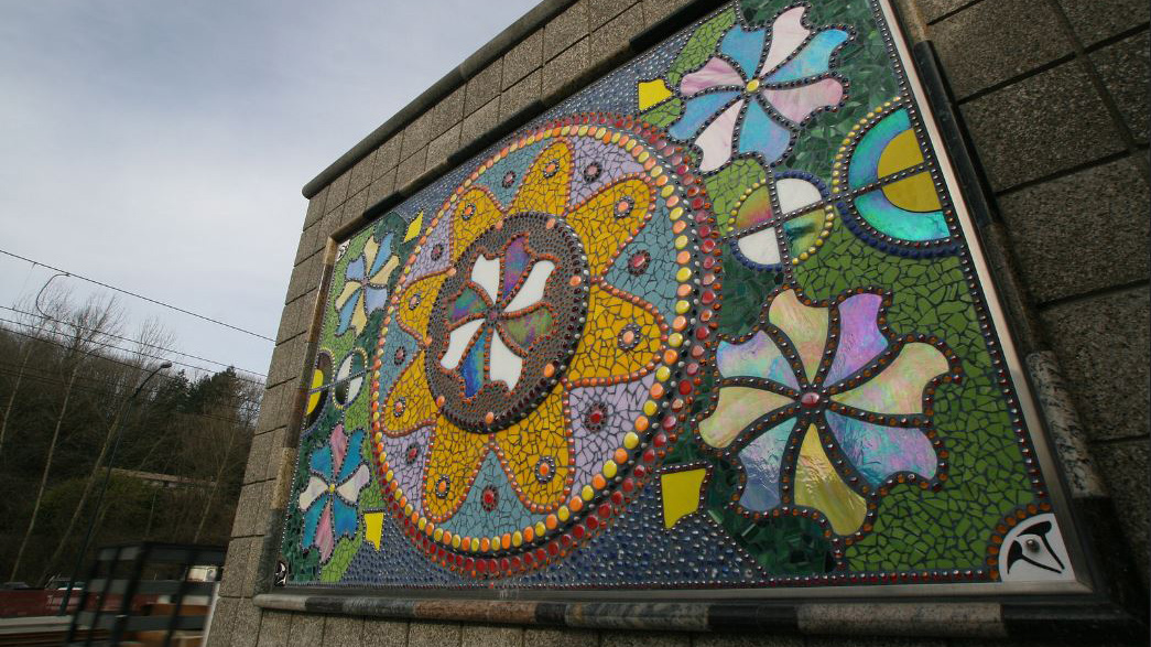 (c) Mauricio Robalino, Flores, Fishmobile Crossing, Pinwheel mosaic and gate, 2009, all rights reserved / Rainier Beach Station, Seattle