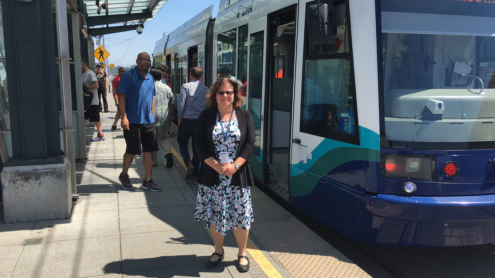 Liz Satterthwaite in front of a Tacoma Link train.