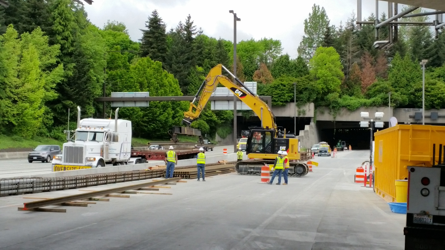 Rail being delivered to the construction site east of the Mercer Island station.