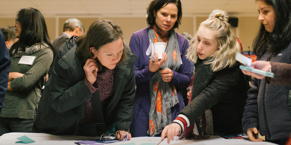 Community members attend a West Seattle and Ballard Link Extension open house.