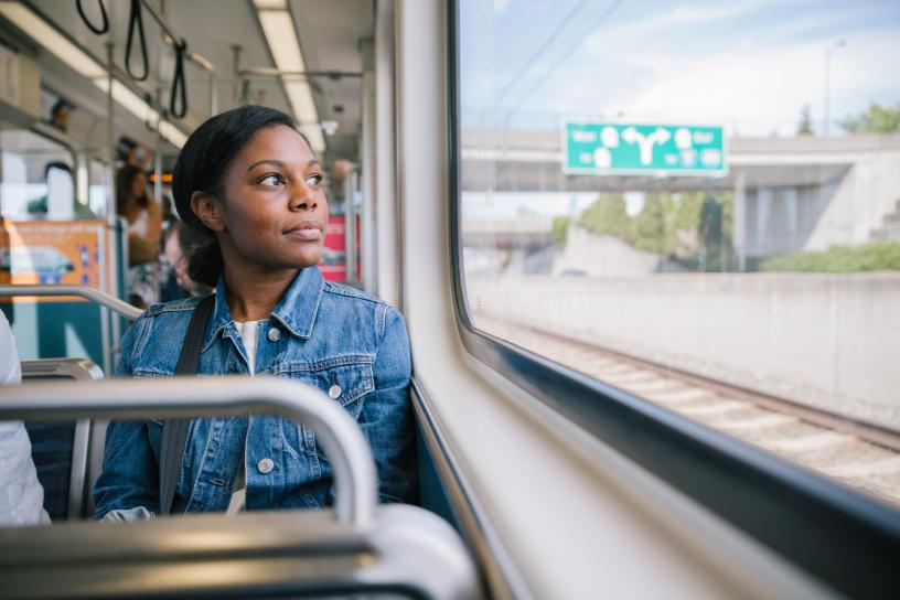 Passenger looks out the window while riding the Link light rail.
