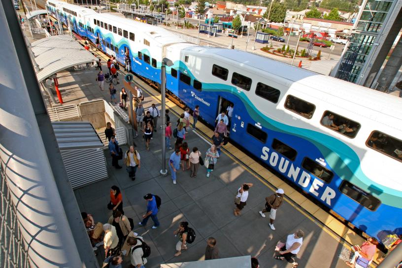 An aerial view of the Auburn Station platform as passengers disembark from a Sounder train.