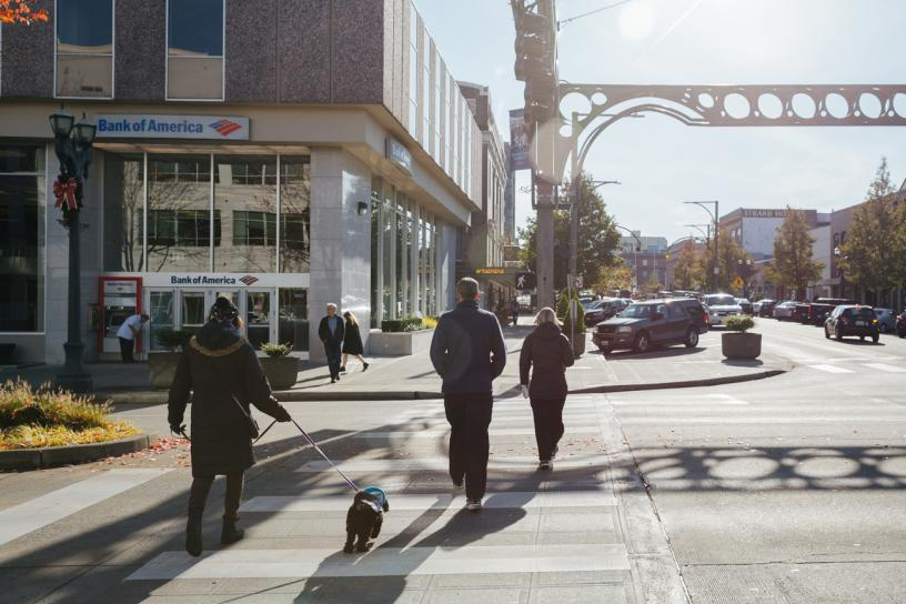 People cross the street toward a Bank of America in downtown Everett.