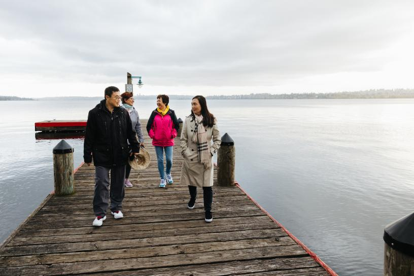 People walk on a pier at Marina Park in Kirkland.