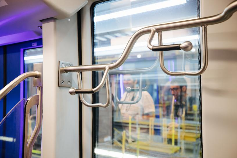 The new Link light rail vehicles have four bike hooks per car. The current fleet has two per car.