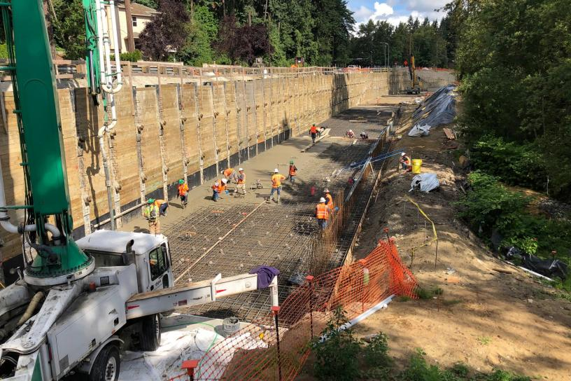 Crews place concrete in the light rail trench adjacent to Bellevue Way Southeast.