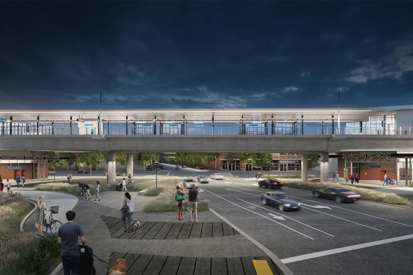 Design visualization of the downtown station straddling NE 166th Street at night.