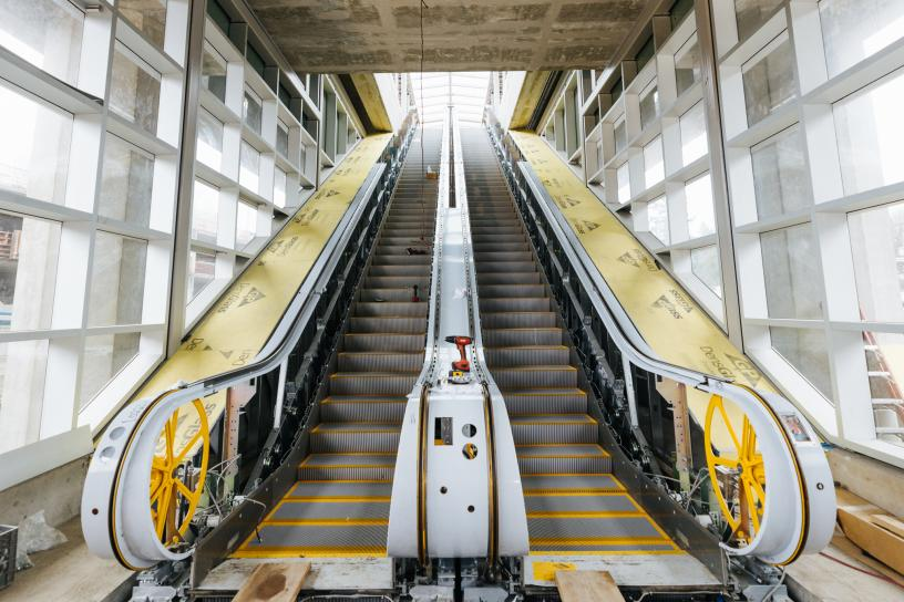 Photo of escalators leading up to the elevated platform at South Bellevue Station.