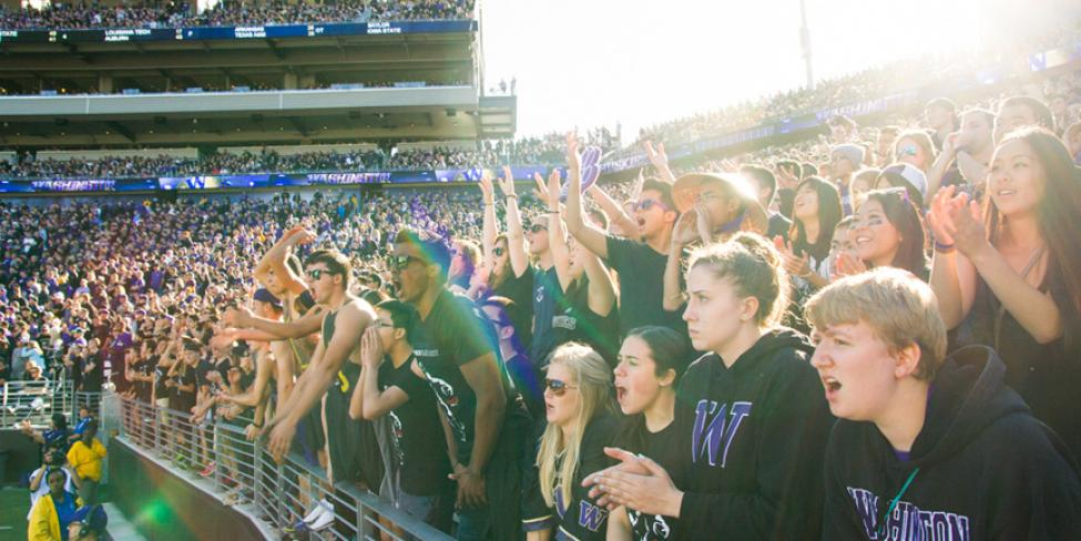 Fans attend a University of Washington Husky football game at Husky Stadium.