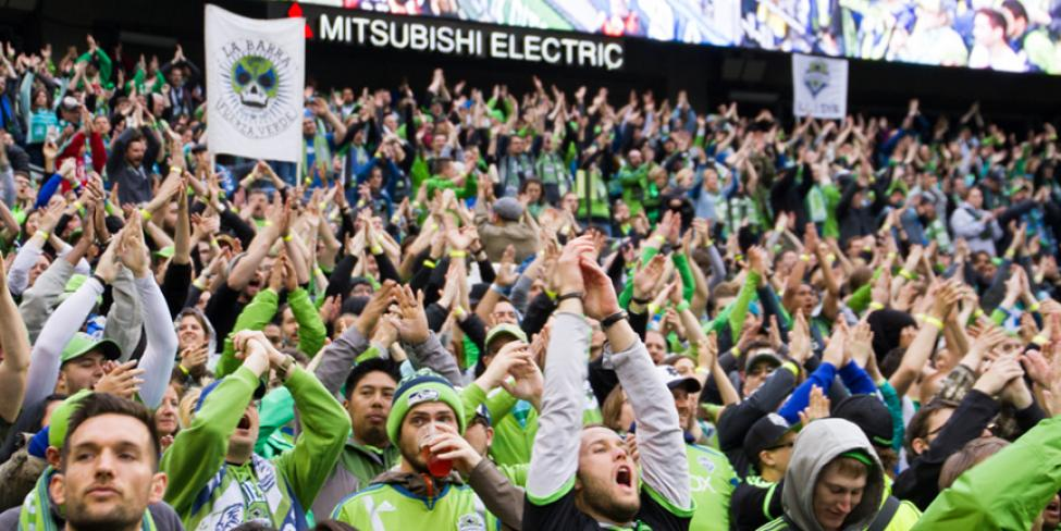 Fans cheer at a Sounders FC match.
