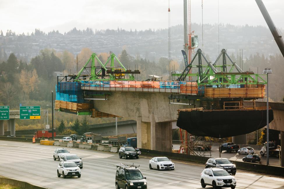 "A view of the ""traveler"" atop one of the East Link columns as it builds a new bridge over the I-90 roadway."