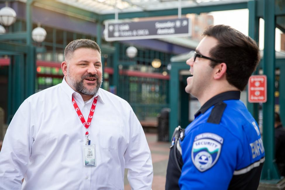 Ken Cummins, Sound Transit Director of Safety and Security jokes with a Security Officer