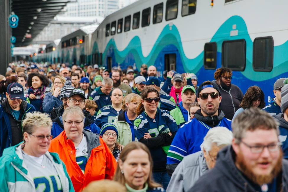 2018 in review: Seahawks fans fill the Sounder platform on their way to a game.