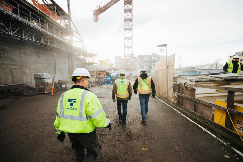 Workers walking on the Roosevelt Station construction site