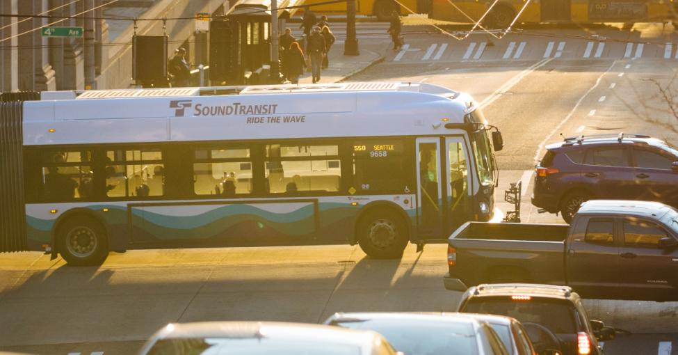 A Sound Transit bus travels through downtown Seattle