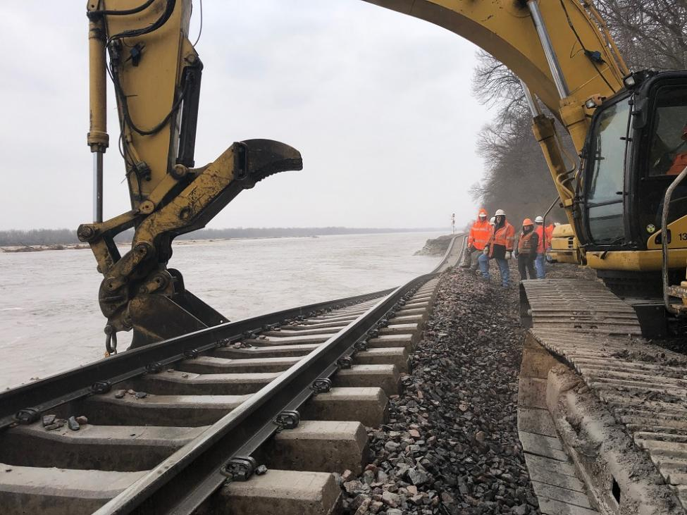 Burlington Northern Santa Fe workers repair a section of track along the flooded Missouri River. Photo courtesy BNSF.