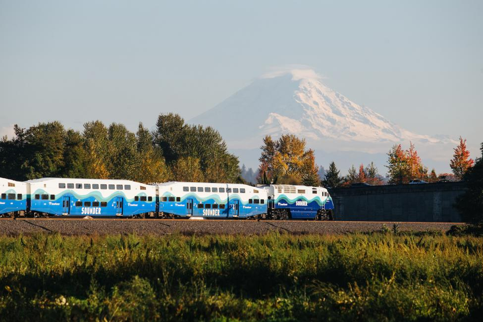 A Sounder commuter rail train with Mt. Rainier in the distance