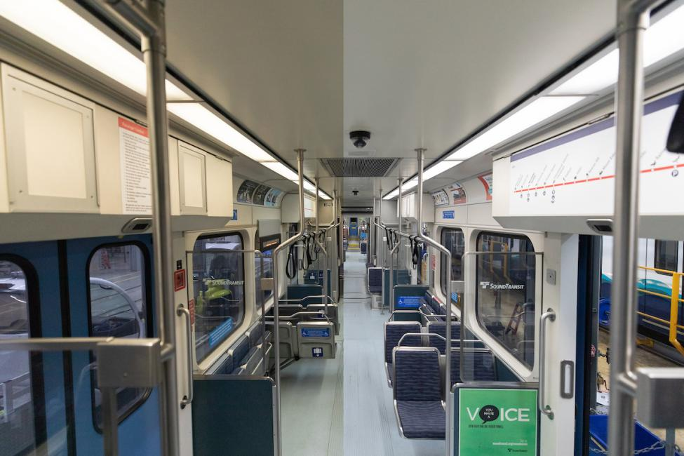 A look at a Link light rail train with LED lights on one side and the old lighting on the other side. The LED side is much more crisp and bright.
