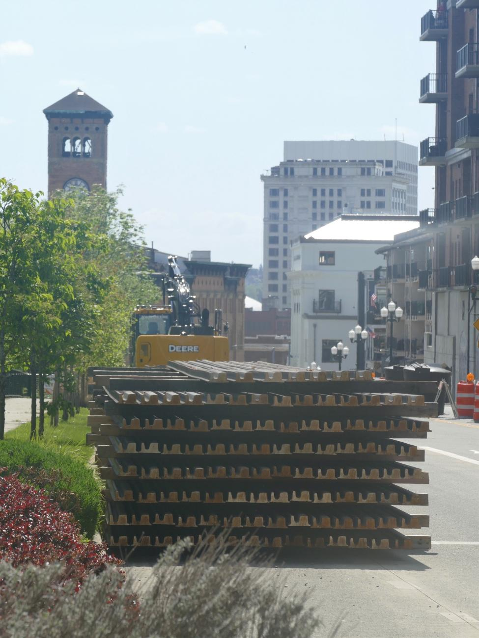 The Old City Hall is seen in the background behind a set of link rails for installation.