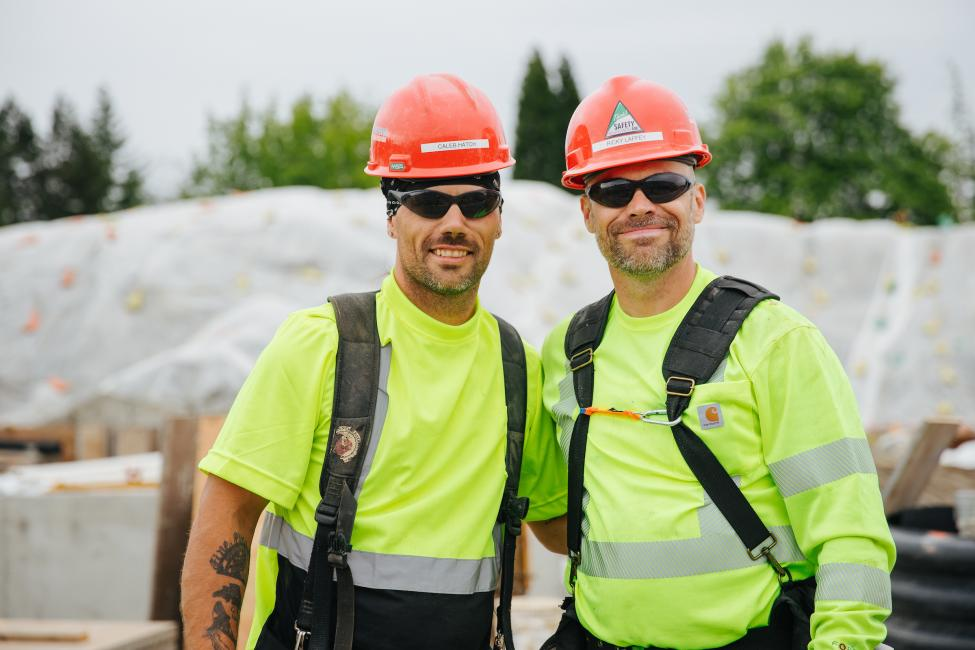 Richard Laffey smiles with his brother Caleb Hatch. They both work on Sound Transit's East Link project.