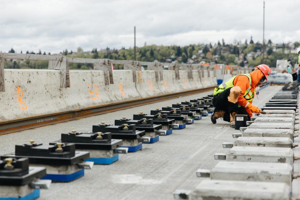 A worker installing the special blocks on I-90 which the light rail tracks will rest on.