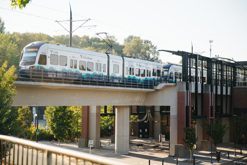 A light rail vehicle travels along a guideway.