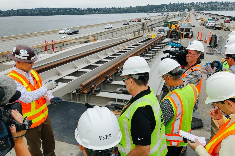 Sound Transit staff explain to media how rails will be installed on the I-90 bridge.