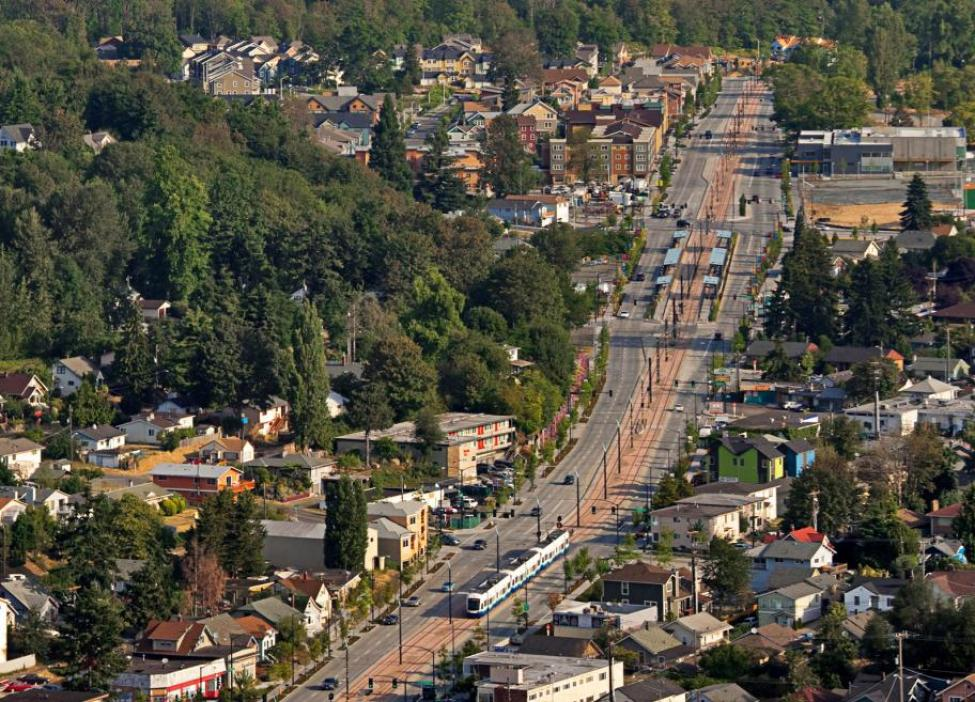An aerial shot of Link light rail running through Seattle's Rainier Valley.