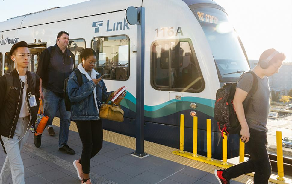Riders board and exit a Link light rail train.