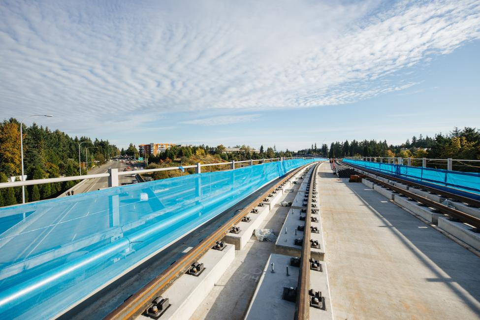 A light rail bridge crosses over 148th Avenue in Redmond.