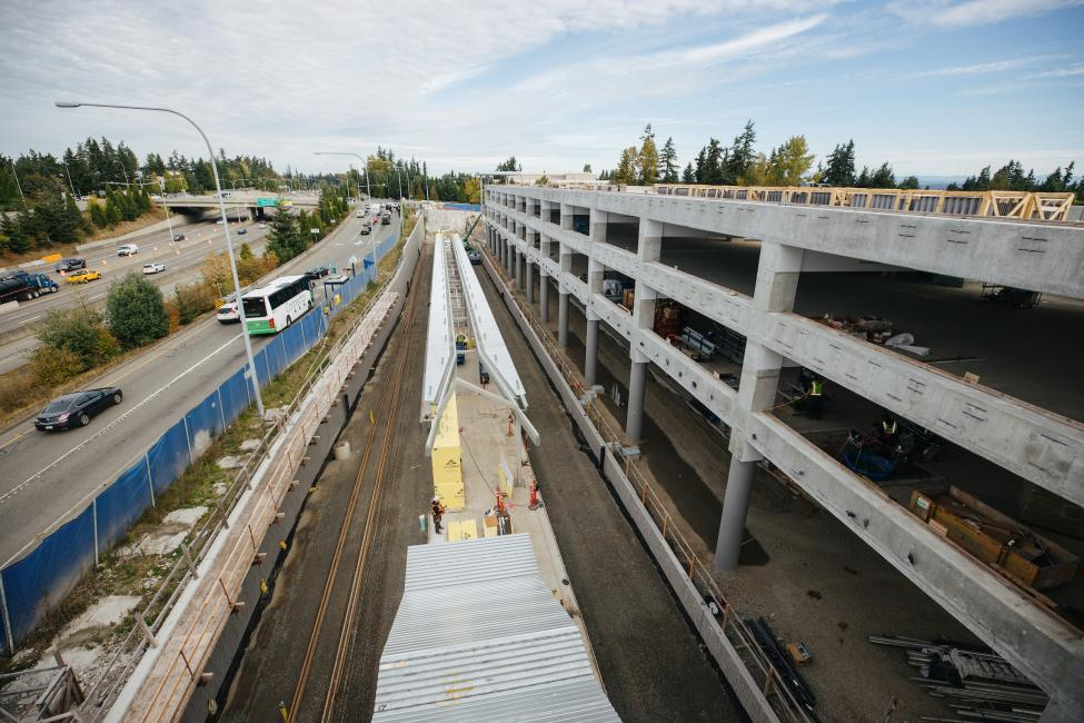 A platform and parking garage are under construction in Redmond, near Microsoft headquarters. SR 520 can be seen on the left side of the photo.