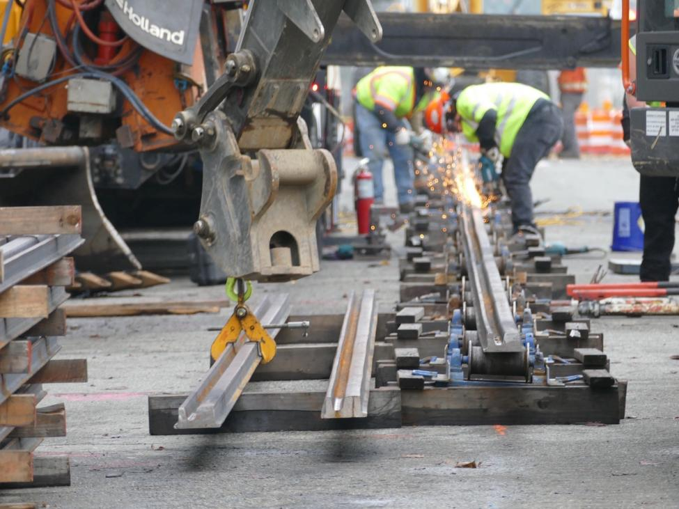 Crews weld sections of rail together in Tacoma.
