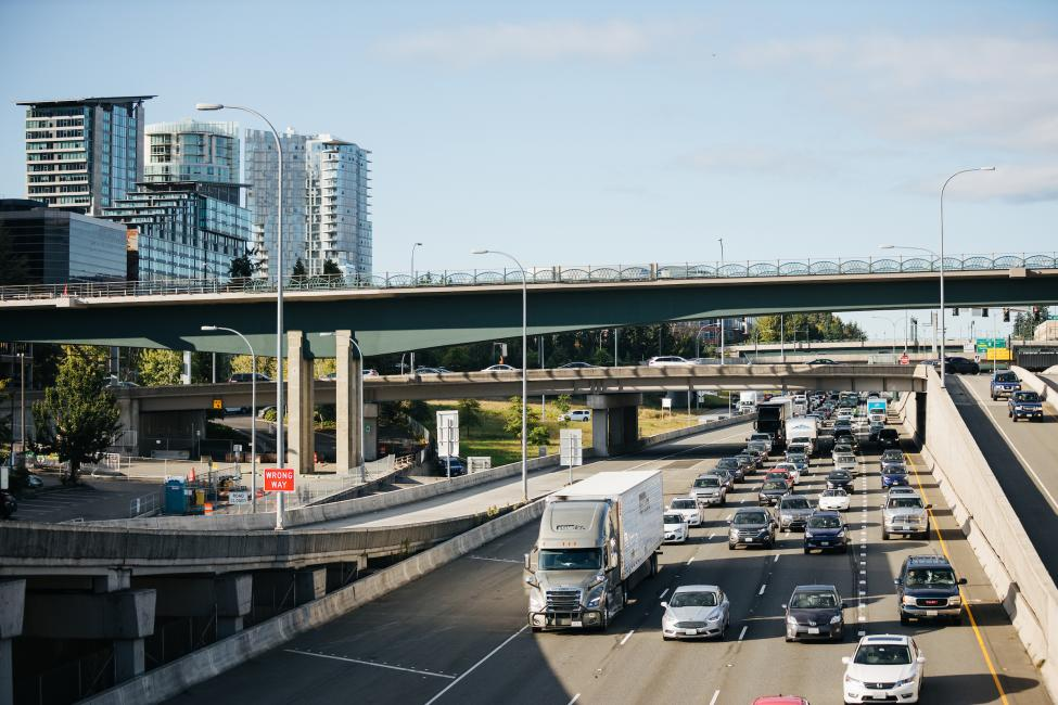 Cars drive on southbound I-405, under the new light rail bridge in downtown Bellevue.