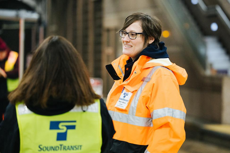 Executive Operations Director Marie Olson talks with staff at the Pioneer Square Station center platform.
