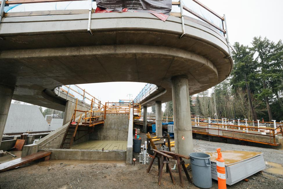 An elevated pedestrian path under construction at Overlake Village Station.