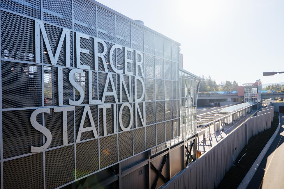 Large block letters on the side of a transit center read 'Mercer Island Station.'