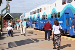 Passengers deboard a Sounder train at the Sumner Station.