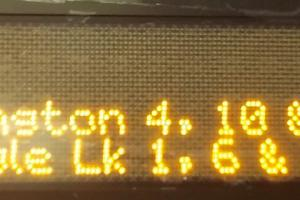 Real-time train arrival information displayed at a Westlake Station sign