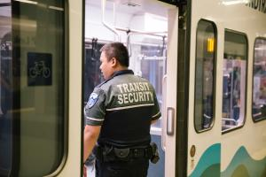 Sound Transit Security boards a Link light rail train