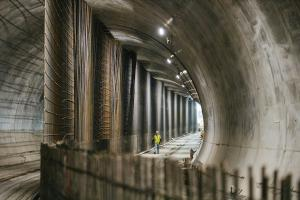 Construction worker walks under downtown Bellevue in the new light rail tunnel.