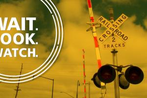 "A graphic depicts a rail crossing with the text ""Wait. Look. Watch."""